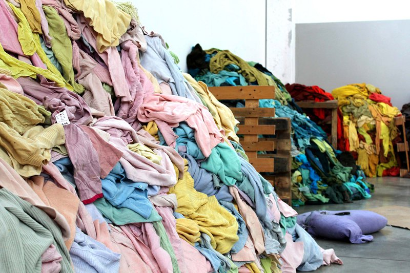 Large piles of coloured clothes