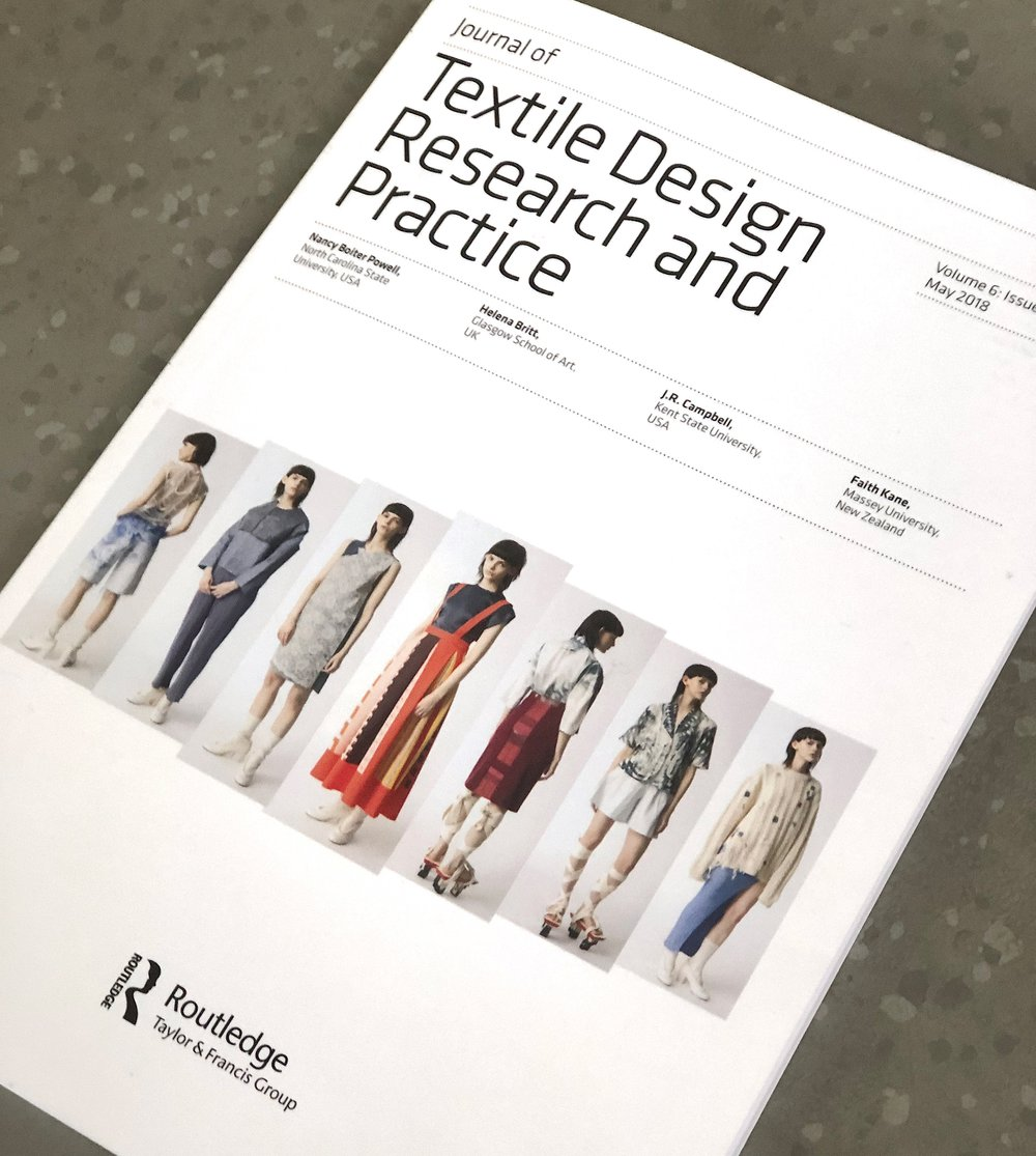 A photo of a report called 'Textile Design Research and Practice'