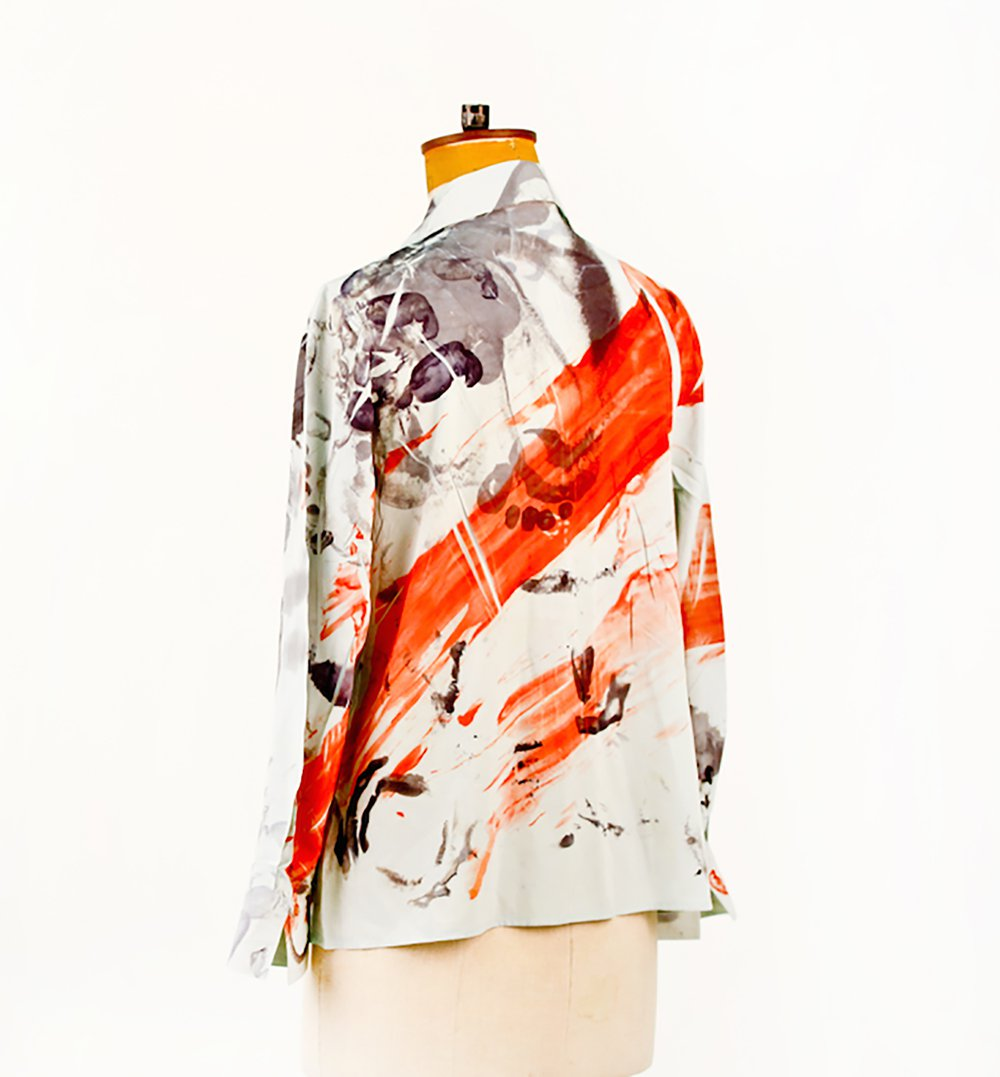 An abstract  shirt displayed on a mannequin